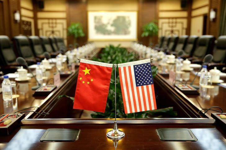 FILE PHOTO: Flags of U.S. and China are placed for a meeting in Beijing