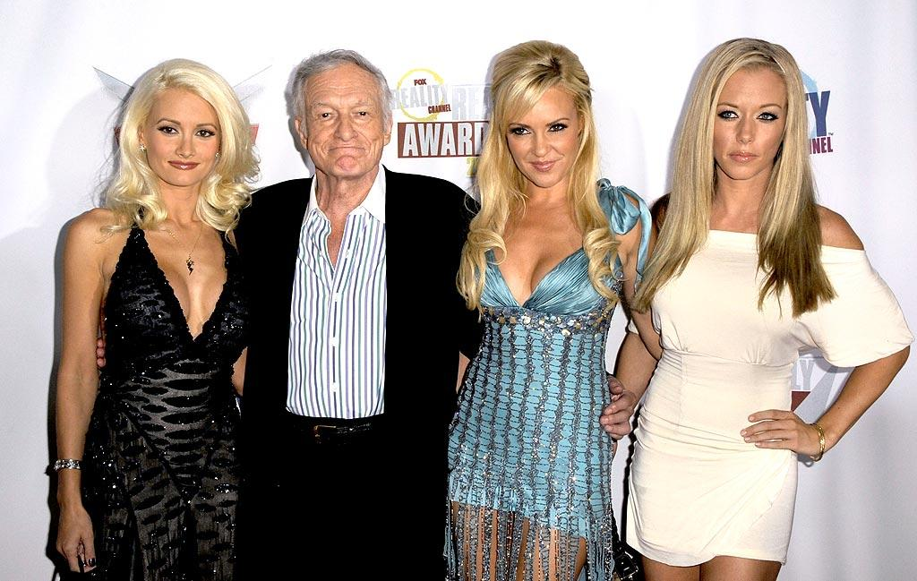 """Although Hugh Hefner has confirmed that he and longtime gal pal Holly Madison (left) have broken up, the Playboy magazine founder still walked the red carpet with Holly and the other """"Girls Next Door,"""" Bridget Marquardt and Kendra Wilkinson. Frazer Harrison/<a href=""""http://www.gettyimages.com/"""" target=""""new"""">GettyImages.com</a> - September 24, 2008"""