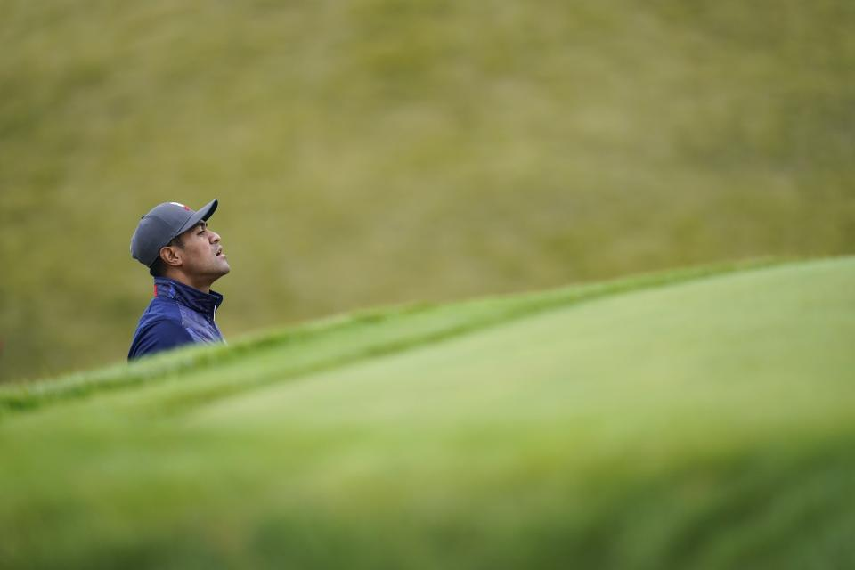 Team USA's Tony Finau looks at a shot on the sixth hole during a practice day at the Ryder Cup at the Whistling Straits Golf Course Tuesday, Sept. 21, 2021, in Sheboygan, Wis. (AP Photo/Ashley Landis)