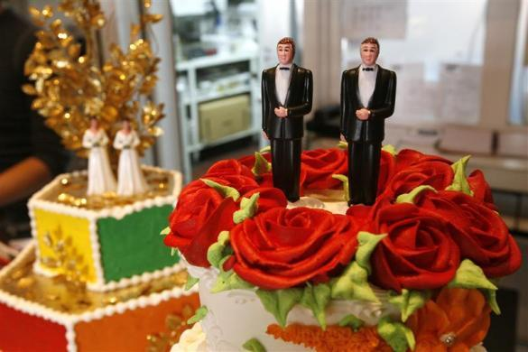 Bride and groom figurines are on display on wedding cakes at Cake and Art bakery in West Hollywood, California June 4, 2008. A California Supreme Court ruling clears the way for gay marriage ceremonies that could bring a business windfall to San Francisco and other cities.