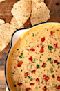 """<p>Skip the jarred stuff and make your own this year.</p><p>Get the recipe from <a href=""""https://www.delish.com/cooking/recipe-ideas/a25647686/queso-dip-recipe/"""" rel=""""nofollow noopener"""" target=""""_blank"""" data-ylk=""""slk:Delish"""" class=""""link rapid-noclick-resp"""">Delish</a>.</p>"""