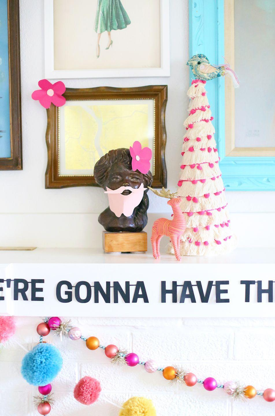 "<p>Another fun way to add a pop of texture and color to your decor? Fringed trees. The DIY won't take hours, either. All you need is a foam cone, some yarn, and a little hot glue. </p><p><em>Get the tutorial at <a href=""https://thepapermama.com/2017/11/hap-hap-happiest-christmas-banner/"" rel=""nofollow noopener"" target=""_blank"" data-ylk=""slk:The Paper Mama"" class=""link rapid-noclick-resp"">The Paper Mama</a>.</em></p><p><a class=""link rapid-noclick-resp"" href=""https://www.amazon.com/Craft-Foam-Cone-Centerpiece-Polystyrene/dp/B07C97HKKH?tag=syn-yahoo-20&ascsubtag=%5Bartid%7C10072.g.34484299%5Bsrc%7Cyahoo-us"" rel=""nofollow noopener"" target=""_blank"" data-ylk=""slk:SHOP FOAM CONES"">SHOP FOAM CONES</a></p>"