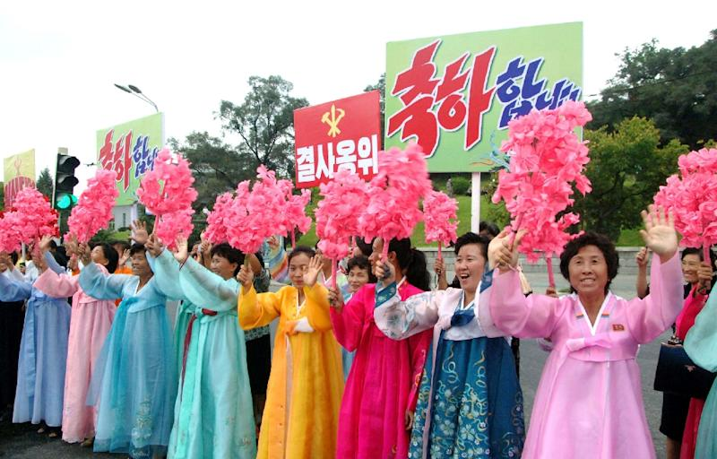 Pyongyang citizens lined the streets to wave pom-poms and cheer a convoy of buses carrying the scientists involved in carrying out North Korea's largest nuclear blast to date (AFP Photo/STR)