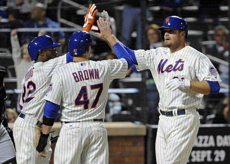 New York Mets' Lucas Duda, right, celebrates with teammates Andrew Brown (47) and Eric Young, Jr. after hitting a three-run home run during the sixth inning of a baseball game against the Miami Marlins, Friday, Sept. 13, 2013, in New York. (AP Photo/Bill Kostroun)