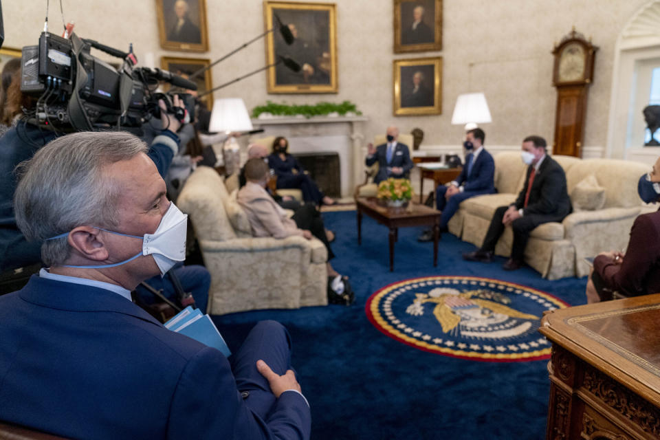 Rep. John Katko, R-N.Y., left, attends a meeting with President Joe Biden, Vice President Kamala Harris, and Transportation Secretary Pete Buttigieg, background, and other members of the House of Representatives in the Oval Office of the White House in Washington, Thursday, March 4, 2021, on infrastructure. (AP Photo/Andrew Harnik)