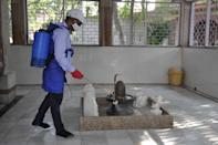 NOIDA, INDIA - JUNE 8: A Shiva temple is sanitized as it opens to the public at Sector 2 on June 8, 2020 in Noida, India. (Photo by Sunil Ghosh/Hindustan Times via Getty Images)