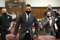 Actor Cuba Gooding Jr., center, approaches the defense table with his lawyer Marc Heller, foreground right, during a hearing in his sexual misconduct case, Thursday, Aug. 13, 2020, in New York. A judge ordered the courtroom outfitted with Plexiglas and other measures to prevent the spread of the coronavirus, which has delayed the trial indefinitely. (Steven Hirsch/New York Post via AP, Pool)