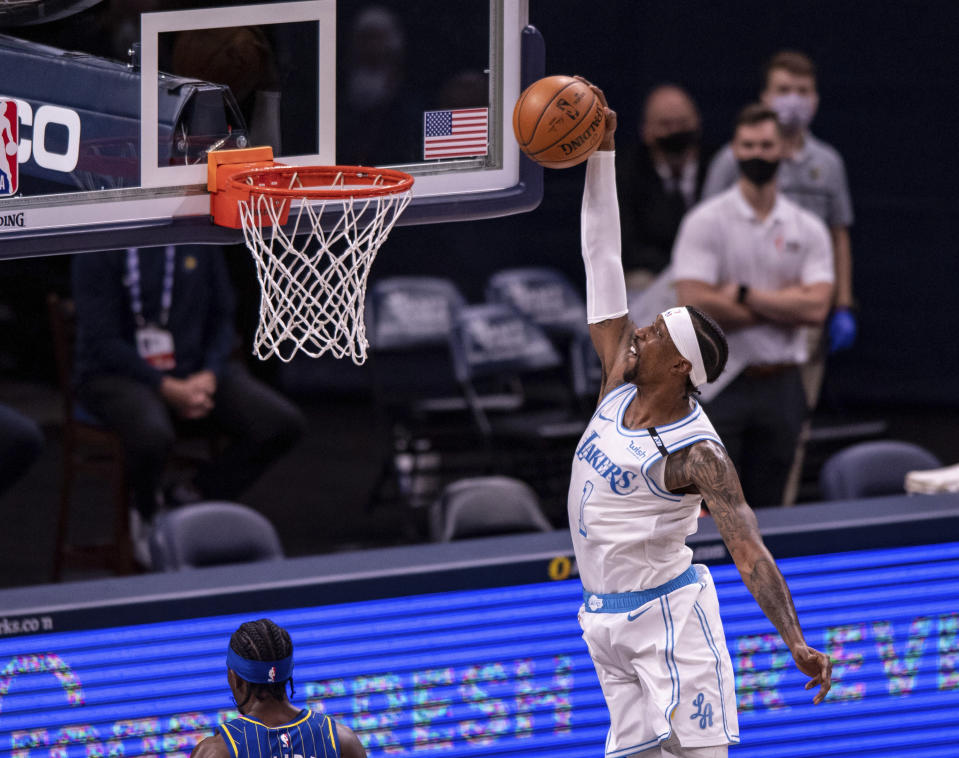 Los Angeles Lakers guard Kentavious Caldwell-Pope (1) dunks during the second half of an NBA basketball game against the Indiana Pacers in Indianapolis, Saturday, May 15, 2021. (AP Photo/Doug McSchooler)
