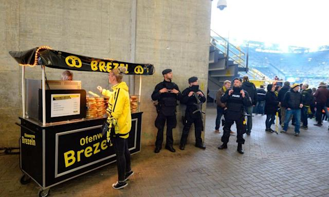 "<span class=""element-image__caption"">Police patrols at Signal Iduna Park prior to the rearranged Champions League quarter-final between Borussia Dortmund and Monaco.</span> <span class=""element-image__credit"">Photograph: Sascha Schuermann/AFP/Getty Images</span>"
