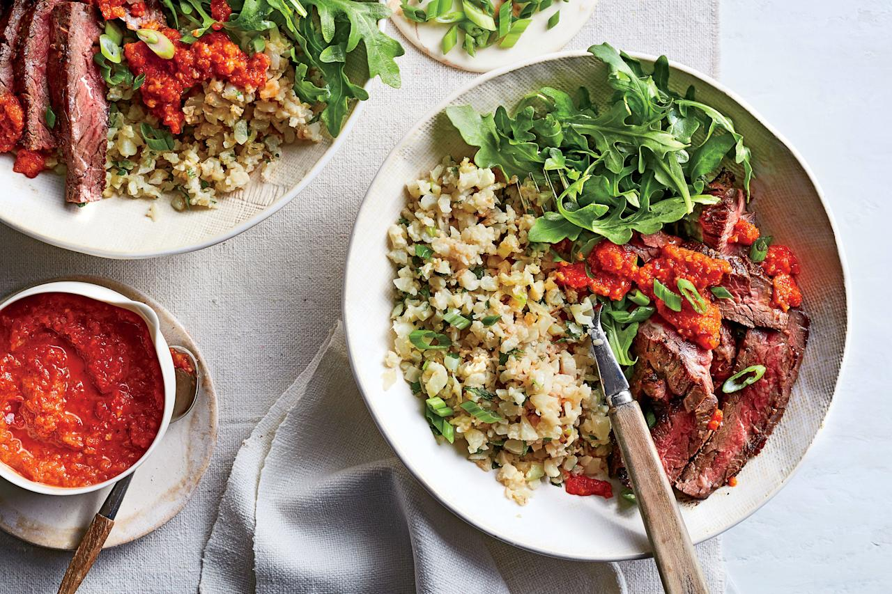 """<p><strong>Recipe: <a href=""""https://www.southernliving.com/recipes/skirt-steak-cauliflower-rice-red-pepper-sauce-recipe"""">Skirt Steak and Cauliflower Rice with Red Pepper Sauce</a></strong></p> <p>Your weeknight deserves this healthy one-bowl meal that gets a flavorful finish from red pepper sauce. Tip: Feel free to use frozen """"riced"""" cauliflower.</p>"""