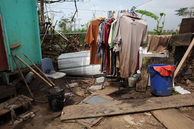 <p>Clothes are seen on a rack outside a home, after Hurricane Maria hit the island in September, in Toa Baja, Puerto Rico, Oct. 18, 2017. (Photo: Alvin Baez/Reuters) </p>