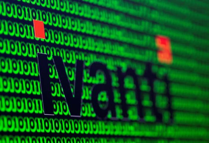 FILE PHOTO: The Ivanti logo and cyber binary codes are seen in this illustration