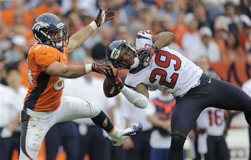 Denver Broncos tight end Jacob Tamme (84) breaks up a pass intended for Houston Texans strong safety Glover Quin (29) in the fourth quarter of an NFL football game Sunday, Sept. 23, 2012, in Denver. (AP Photo/Jack Dempsey)