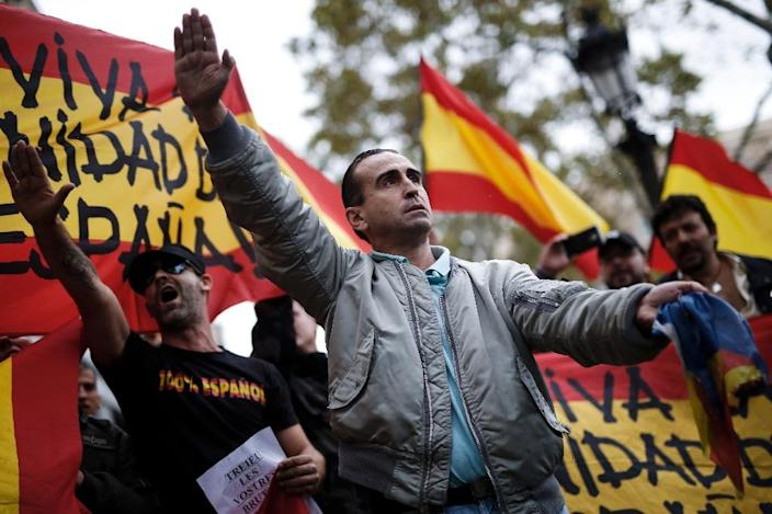 There has also been an increase in shows of patriotism calling for Spanish unity (AFP Photo/PAU BARRENA)