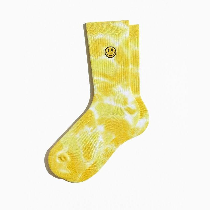 "Statement socks are (almost) always a good idea. $10, Urban Outfitters. <a href=""https://www.urbanoutfitters.com/shop/smile-face-sport-crew-sock?color=072&type=REGULAR&size=ONE%20SIZE&quantity=1"" rel=""nofollow noopener"" target=""_blank"" data-ylk=""slk:Get it now!"" class=""link rapid-noclick-resp"">Get it now!</a>"