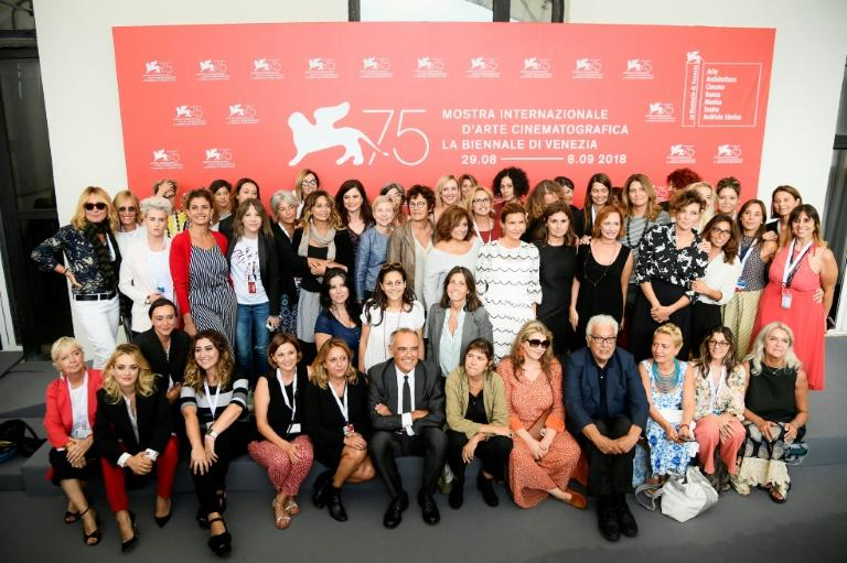 Festival Director Alberto Barbera (bottom C) and President of the Venice Biennale, Paolo Baratta (4th R bottom) are pictured with women working in the film, television and media industry in Italy, after signing  a pledge on gender parity at the Venice Film Festival