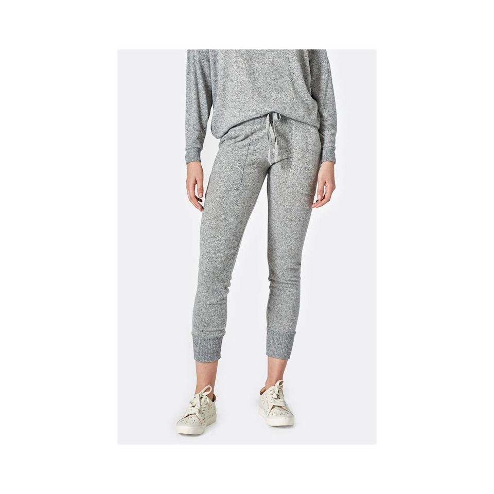 """<p>The slim fit and ribbed finish at the ankle elevate the casualness of these Joie Tendra Sweats without compromising on comfort. These will be an easy throw-on-and-go option for quick grocery store runs or your fifth trip to the fridge. Shop the equally as cozy <a href=""""https://www.anrdoezrs.net/links/8984085/type/dlg/sid/BestLoungewearSets/https://www.joie.com/giardia-sweater-heather-grey"""" rel=""""nofollow noopener"""" target=""""_blank"""" data-ylk=""""slk:Jennina Sweatshirt"""" class=""""link rapid-noclick-resp"""">Jennina Sweatshirt</a> to complete the look. </p> <p><strong>Sizes available:</strong> XXS to XL</p> <p><strong>$118</strong> (<a href=""""https://www.anrdoezrs.net/links/8984085/type/dlg/sid/AllureCozyLoungewear/https://www.joie.com/tendra-jogger-pant-heather-grey?"""" rel=""""nofollow noopener"""" target=""""_blank"""" data-ylk=""""slk:Shop Now"""" class=""""link rapid-noclick-resp"""">Shop Now</a>)</p>"""