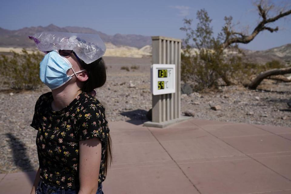 a woman with a bag of ice on her head in Death Valley National Park