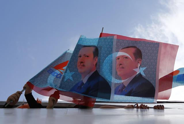 <p>Supporters of Turkey's Prime Minister and presidential candidate Tayyip Erdogan wave flags in a boat on their way to an election rally in Istanbul August 3, 2014. (Murad Sezer/Reuters) </p>