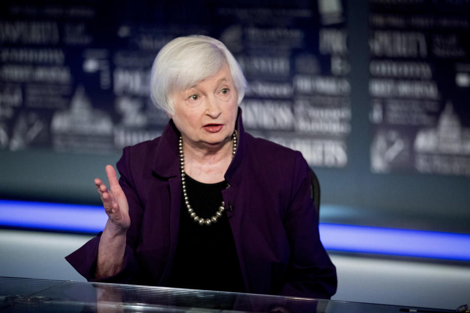 FILE - In this Aug. 14, 2019, file photo former Fed Chair Janet Yellen speaks with FOX Business Network guest anchor Jon Hilsenrath in the Fox Washington bureau in Washington. The Treasury Department reported Wednesday, March 10, 2021, that the October through February deficit was 68% larger than the $624.5 billion deficit recorded during the same period last year. (AP Photo/Andrew Harnik, File)