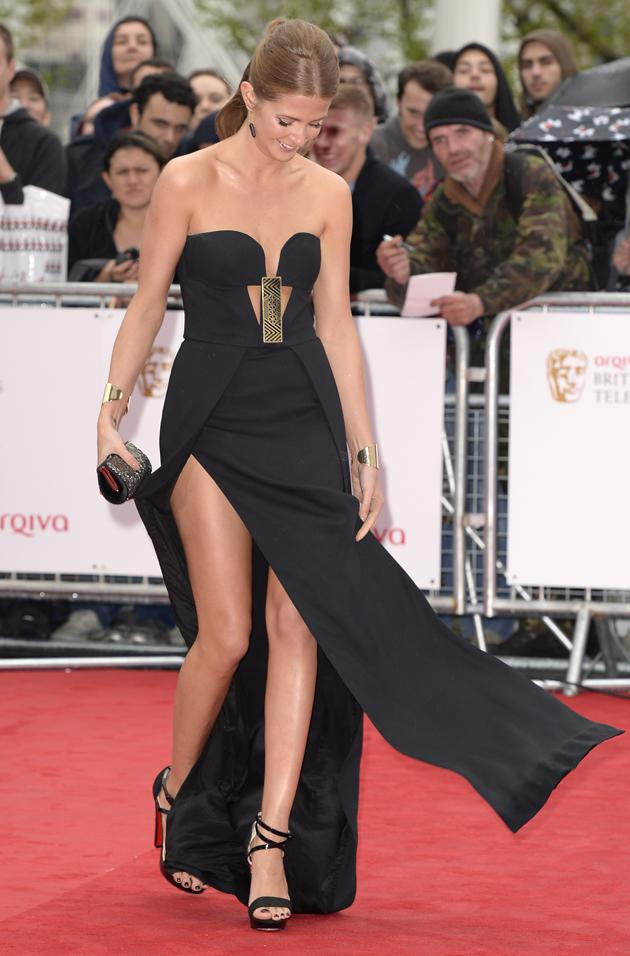 "TV BAFTAS 2013 wardrobe malfunctions: Made in Chelsea's Millie Mackintosh made a major error in opting for a dress with massive thigh-high splits. She even took to Twitter after walking the red carpet to say: ""Wind and rain   a dress with slits = wardrobe malfunction!"" Copyright [Rex]"