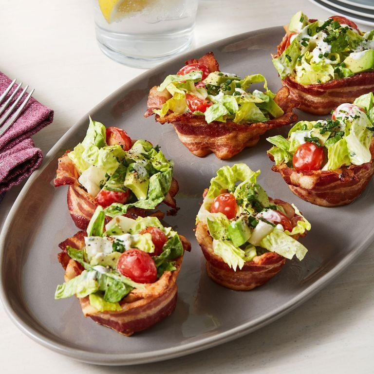 """<p>These <a href=""""https://www.delish.com/uk/cooking/a34435205/blt-egglets-recipe/"""" rel=""""nofollow noopener"""" target=""""_blank"""" data-ylk=""""slk:lighter BLTs"""" class=""""link rapid-noclick-resp"""">lighter BLTs</a> skip the bread and put major emphasis on the <a href=""""https://www.delish.com/uk/cooking/recipes/a30208165/how-to-cook-bacon-in-the-oven-recipe/"""" rel=""""nofollow noopener"""" target=""""_blank"""" data-ylk=""""slk:bacon"""" class=""""link rapid-noclick-resp"""">bacon</a> - which is what we all really want. We replaced the mayo with greek yogurt to help make these lighter as well, but you can use the traditional mayonnaise or even sour cream if you prefer. </p><p>Get the <a href=""""https://www.delish.com/uk/cooking/recipes/a35147325/blt-cups-recipe/"""" rel=""""nofollow noopener"""" target=""""_blank"""" data-ylk=""""slk:BLT Cups"""" class=""""link rapid-noclick-resp"""">BLT Cups</a> recipe.</p>"""