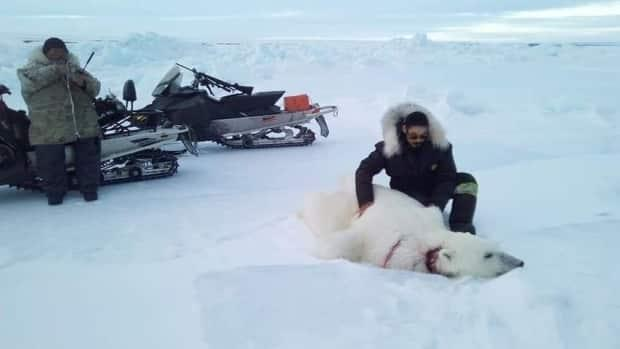 Joseph Kuptana with the polar bear he hunted from behind an iceberg. (Submitted by Joseph Kuptana - image credit)