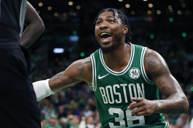 Boston Celtics' Marcus Smart reacts to a call during the second half of an NBA basketball game against the Toronto Raptors in Boston, Friday, Oct. 25, 2019. (AP Photo/Michael Dwyer)