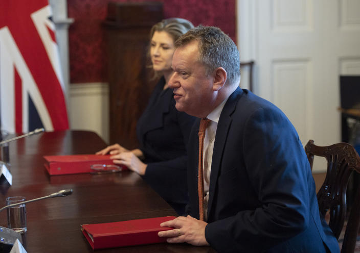 """Britain's Minister for the Cabinet Office of the United Kingdom, David Frost, speaks to his EU counterpart Maros Sefcovic, during a meeting, in London, Wednesday, June 9, 2021. The U.K. has called upon the European Union to show pragmatism and """"common sense,"""" as the two sides meet to resolve differences over the deal that was supposed to keep trade flowing in Northern Ireland after Brexit. (Eddie Mulholland/Pool Photo via AP)"""