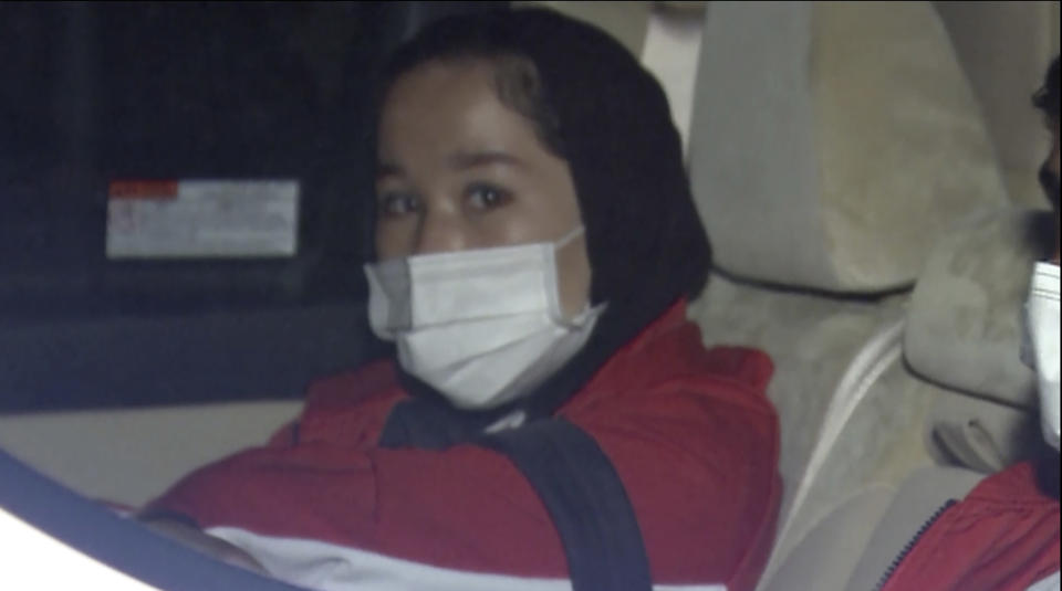 In this image made from a video, Afghan athlete Zakia Khudadadi arrives at Haneda airport in Tokyo Saturday, Aug. 28, 2021. Afghan athletes Khudadadi and Hossain Rasouli have arrived in Tokyo, via what's been described as a harrowing journey from Kabul to Paris, to compete in the Paralympics. (TBS via AP)