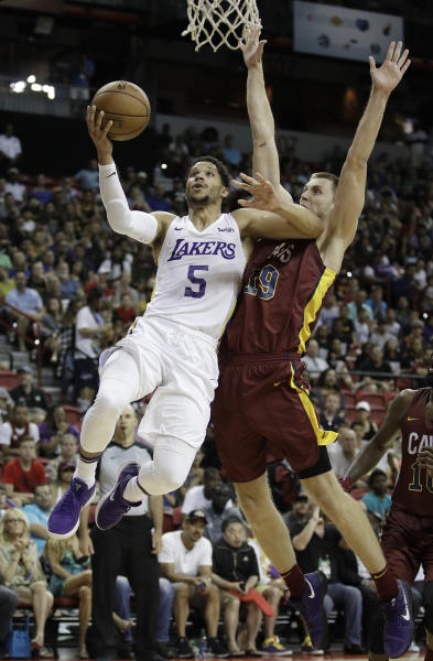 Los Angeles Lakers' Josh Hart shoots around Cleveland Cavaliers' Vladimir Brodziansky during overtime of an NBA summer league basketball game, Monday, July 16, 2018, in Las Vegas. (AP Photo/John Locher)