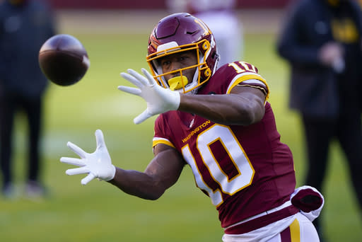 Washington Football Team wide receiver Antonio Gandy-Golden (10) makes a catch before the start of an NFL football game against the Carolina Panthers and Washington Football Team, Sunday, Dec. 27, 2020, in Landover, Md. (AP Photo/Susan Walsh)