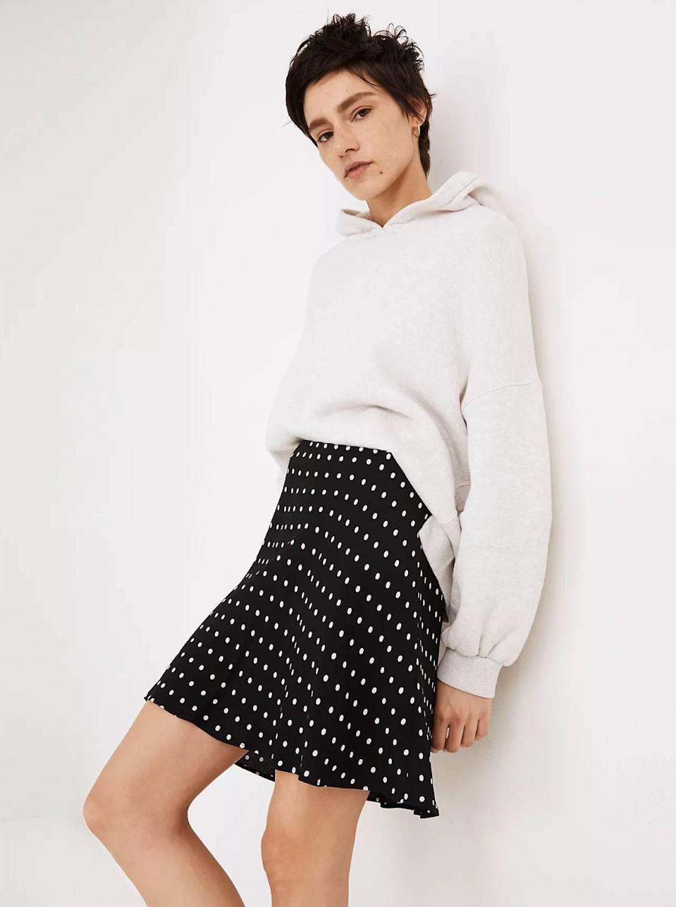 """How adorable is this black-and-white polka dot miniskirt? Pair it with casual staples, like an oversized sweatshirt, as pictured, or a <a href=""""https://www.glamour.com/gallery/the-perfect-white-t-shirt-according-to-glamour-editors?mbid=synd_yahoo_rss"""" rel=""""nofollow noopener"""" target=""""_blank"""" data-ylk=""""slk:plain white tee"""" class=""""link rapid-noclick-resp"""">plain white tee</a>. $79.5, Madewell. <a href=""""https://www.madewell.com/mini-slip-skirt-in-polka-dot-MD219.html?"""" rel=""""nofollow noopener"""" target=""""_blank"""" data-ylk=""""slk:Get it now!"""" class=""""link rapid-noclick-resp"""">Get it now!</a>"""