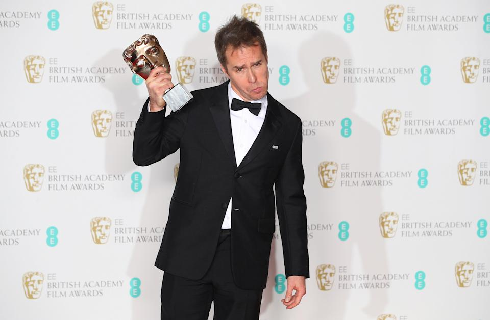 Sam Rockwell shows off his trophy.