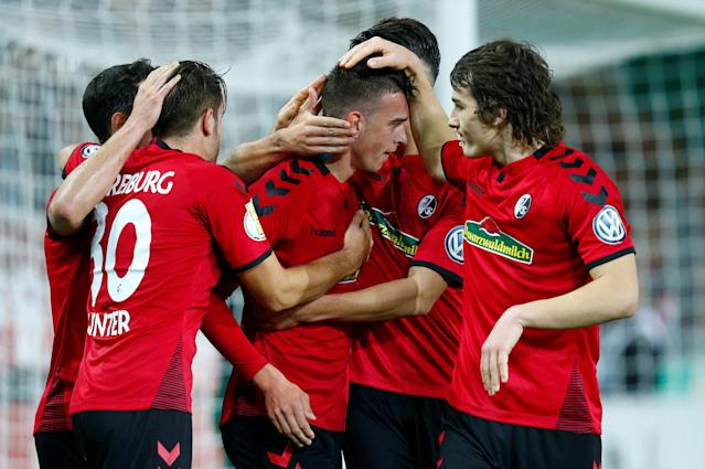 Soccer Football - DFB Cup Second Round - SC Freiburg v Dynamo Dresden - Dreisamstadion, Freiburg, Germany - October 25, 2017 SC Freiburg's Janik Haberer celebrates scoring their third goal with team mates REUTERS/Ralph Orlowski DFB RULES PROHIBIT USE IN MMS SERVICES VIA HANDHELD DEVICES UNTIL TWO HOURS AFTER A MATCH AND ANY USAGE ON INTERNET OR ONLINE MEDIA SIMULATING VIDEO FOOTAGE DURING THE MATCH.