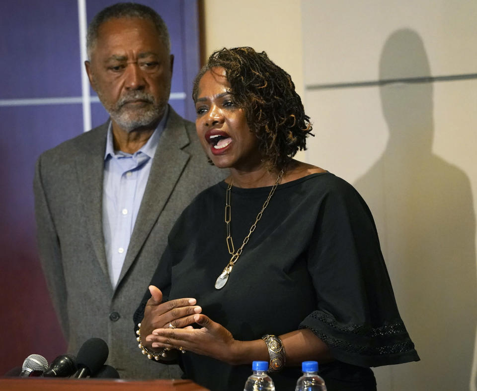 Minneapolis resident and former City Council Member Don Samuels listens as his wife Sondra speaks during a news conference at their attorney's office to discuss where the situation stands regarding language on the future of the Minneapolis policing ballot Wednesday, Sept. 15, 2021, in Minneapolis. A judge struck down ballot language last week that aimed to replace the Minneapolis Police Department with a new agency, which sent the City Council scrambling to approve new language that members hope will stand up. The injunction to keep the language off the ballot was sought by Samuels, his wife, and businessman Bruce Dachis. (David Joles/Star Tribune via AP)