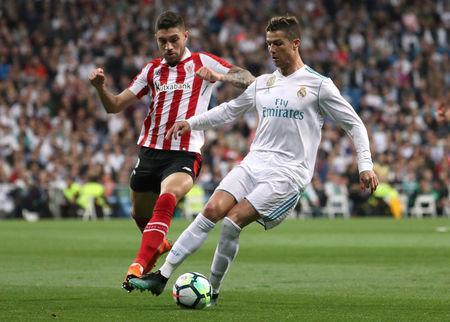 Soccer Football - La Liga Santander - Real Madrid vs Athletic Bilbao - Santiago Bernabeu, Madrid, Spain - April 18, 2018 Real Madrid's Cristiano Ronaldo in action with Athletic Bilbao's Unai Nunez REUTERS/Susana Vera