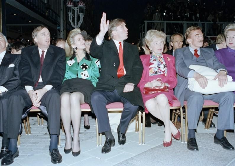 Donald Trump waves to staff members of the Trump Taj Mahal Casino Resort as they cheer him on before the start of the grand opening ceremonies in Atlantic City, N.J., Thursday night on April 5, 1990. Trump attended the gala with his mother, Mary, father, Fred, and sister, the U.S. District Court Judge Maryanne Trump Barry, right. On the left is Donald Trump's brother Robert Trump and his wife Blaine Trump. (AP Photo/Charles Rex Arbogast)