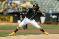 Oakland Athletics starting pitcher Sean Manaea works against the Houston Astros in the first inning of a baseball game in Oakland, Calif., Saturday, Sept. 25, 2021. (AP Photo/John Hefti)
