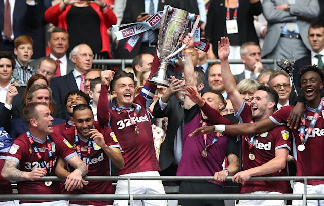 Aston Villa captain Jack Grealish (center) and his teammates celebrate promotion to the Premier League at Wembley Stadium on Monday. (Getty)