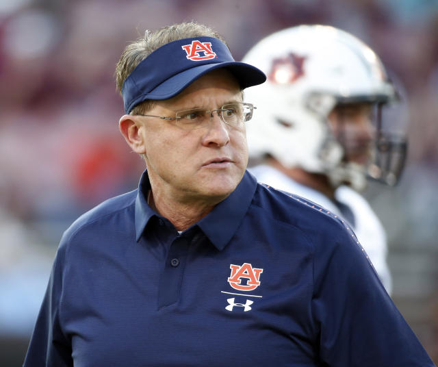 Auburn coach Gus Malzahn, watching players warm up before facing Mississippi State this month, is 5-3 overall and 2-3 in the SEC. (AP)