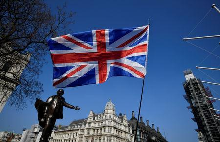 FILE PHOTO: A British flag flutters during the March to Leave demonstration in Parliament square in London, Britain March 29, 2019. REUTERS/Toby Melville