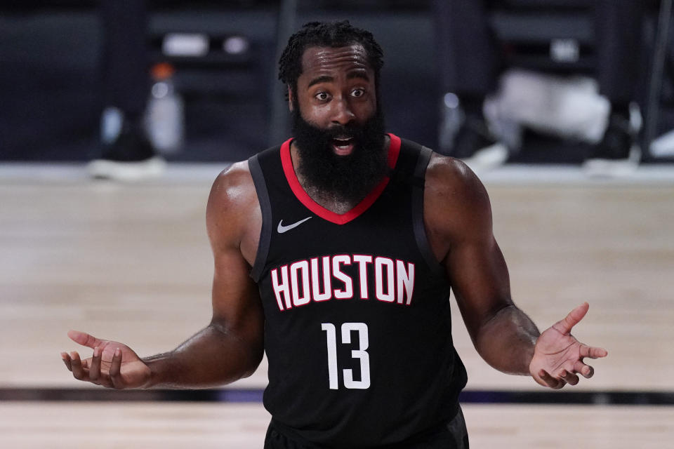 James Harden puts his hands up in shock as he argues a call.