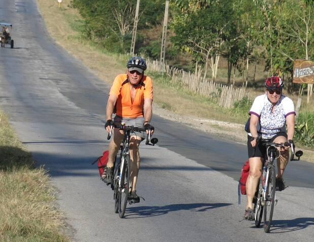 Ish Theilheimer, left, and Kathy Eisner Theilheimer ride the Carratera Centrale in Cuba.