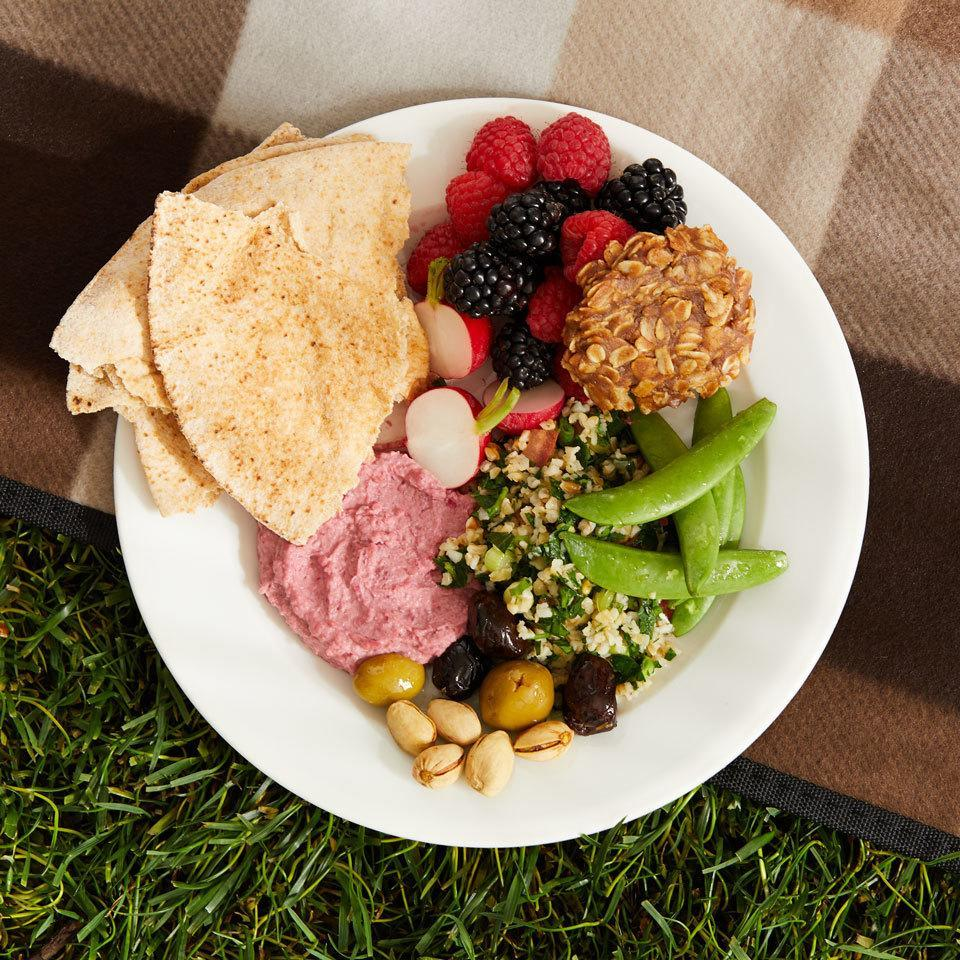 """<p>This Mediterranean-inspired vegan picnic dinner features traditional fare like tabbouleh, hummus, olives and fresh fruit and vegetables. It's perfect to pack and take along or even to serve as an easy, healthy meal at home. <a href=""""http://www.eatingwell.com/recipe/264492/tabbouleh-hummus-pita-plate/"""" rel=""""nofollow noopener"""" target=""""_blank"""" data-ylk=""""slk:View recipe"""" class=""""link rapid-noclick-resp""""> View recipe </a></p>"""