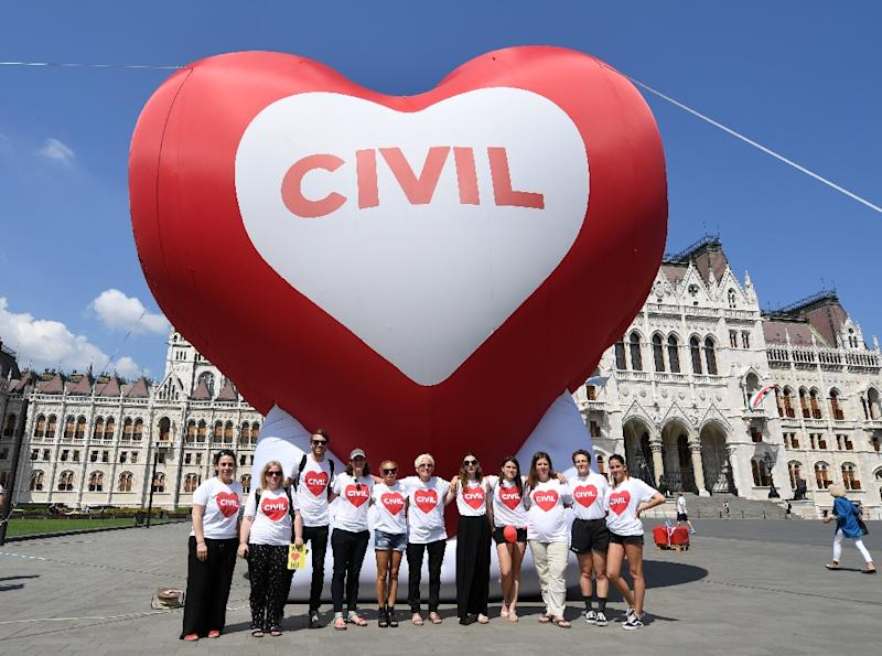 Leading Hungarian NGOs pose with a giant heart-shaped balloon during a demonstration against the so-called 'Stop Soros' laws (AFP Photo/ATTILA KISBENEDEK)