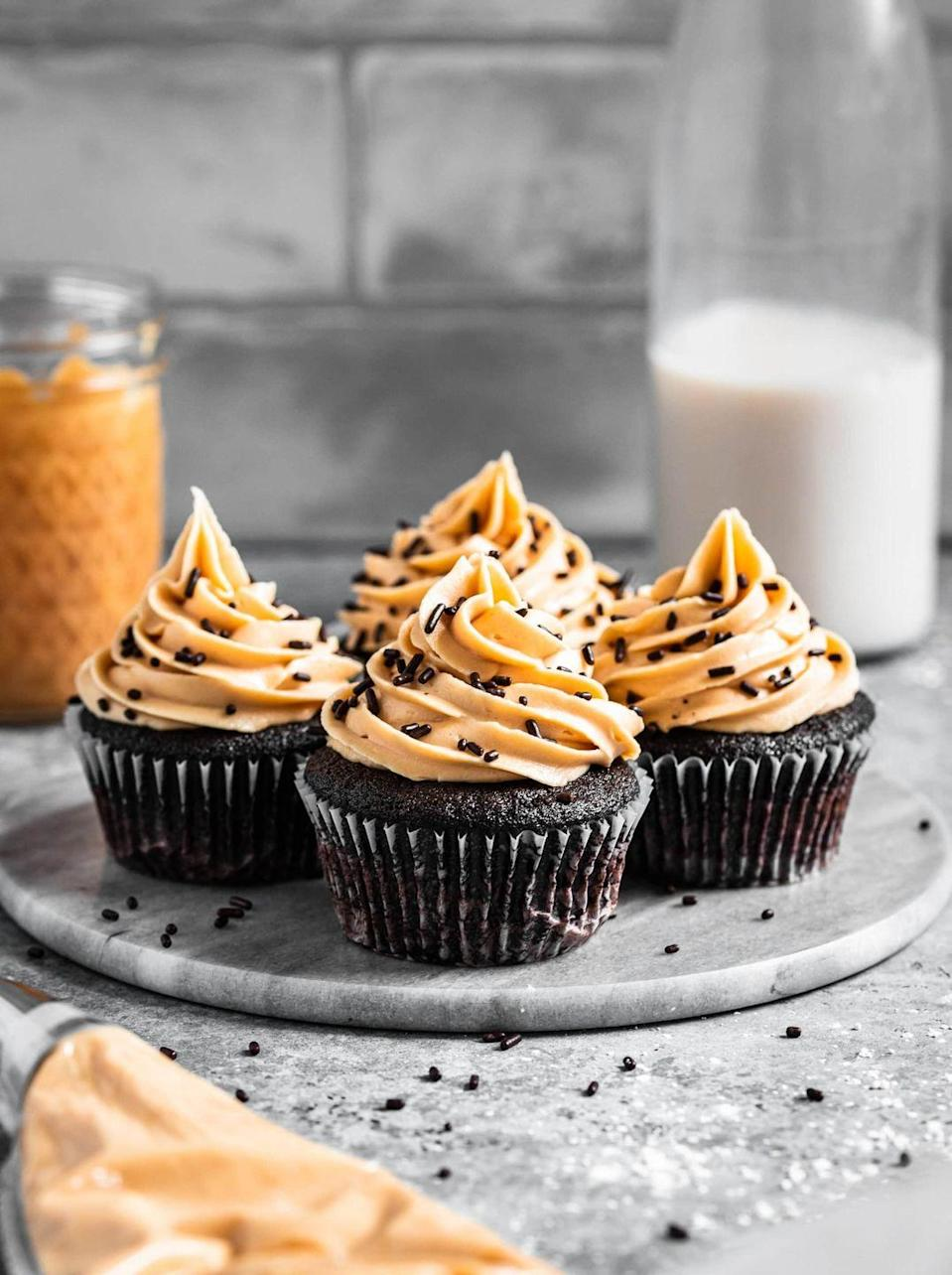 """<p>Make this small batch recipe for peanut butter cupcakes. It's the perfect treat after your romantic dinner.</p><p><strong>Get the recipe at <a href=""""https://mikebakesnyc.com/small-batch-chocolate-cupcakes/"""" rel=""""nofollow noopener"""" target=""""_blank"""" data-ylk=""""slk:Mike Bakes NYC"""" class=""""link rapid-noclick-resp"""">Mike Bakes NYC</a>.</strong></p><p><strong><a class=""""link rapid-noclick-resp"""" href=""""https://go.redirectingat.com?id=74968X1596630&url=https%3A%2F%2Fwww.walmart.com%2Fbrowse%2Fhome%2Fmeasuring-cups%2F4044_623679_8455465_3090752%3Ffacet%3Dbrand%253AThe%2BPioneer%2BWoman&sref=https%3A%2F%2Fwww.thepioneerwoman.com%2Ffood-cooking%2Fmeals-menus%2Fg35139389%2Fvalentines-day-cupcake-ideas%2F"""" rel=""""nofollow noopener"""" target=""""_blank"""" data-ylk=""""slk:SHOP MEASURING TOOLS"""">SHOP MEASURING TOOLS</a><br></strong></p>"""