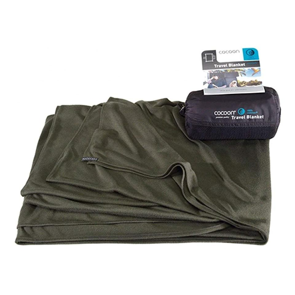 <p>A travel blanket is one of the best items to get cozy with, and the <span>Cocoon CoolMax Blanket</span> ($43) comes with a nifty storage bag so it won't take up space. </p>