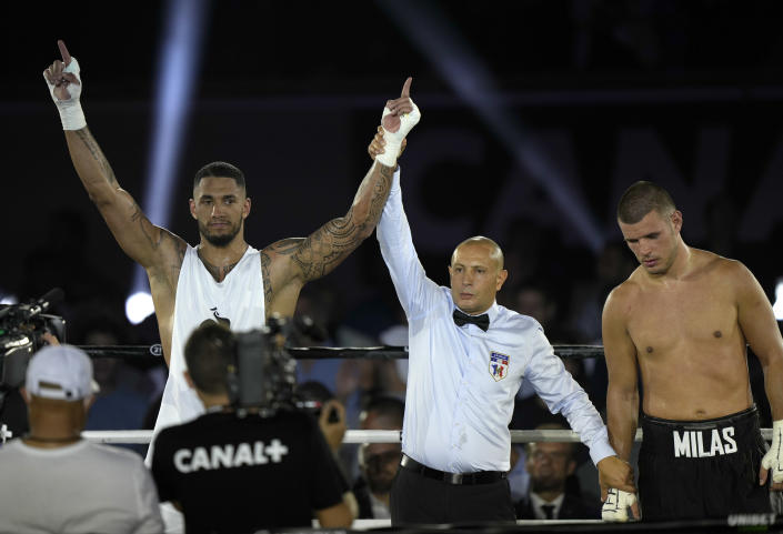 Tony Yoka of France celebrates after he defeated Croatia's Petar Milas in a heavyweight boxing fight on the central court Philippe Chatrier at the Roland Garros tennis stadium, in Paris, Friday, Sept. 10, 2021. (AP Photo/Francois Mori)