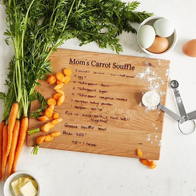 """Now presenting a thoughtful gift for the mom who loves anything engraved: All you have to do is upload or scan a photo of the recipe, and they'll etch her handwriting into the cutting board. $100, Uncommon Goods. <a href=""""https://www.uncommongoods.com/product/personalized-family-recipe-board"""" rel=""""nofollow noopener"""" target=""""_blank"""" data-ylk=""""slk:Get it now!"""" class=""""link rapid-noclick-resp"""">Get it now!</a>"""